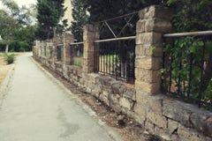 Old stone fence walking path royalty free stock photo