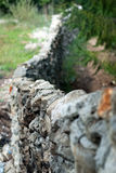 Old stone fence. With wavy form Royalty Free Stock Photo