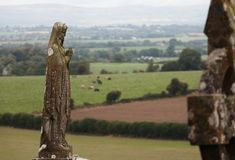 Old stone figure of the Mother of God on the Celtic cemetery stock photography