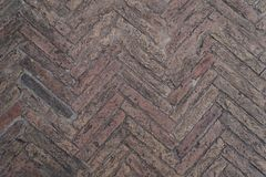 Old stone floor in the form of parquet. Texture background. Vintage effect stock photography