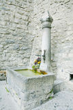 Old stone fountain in Chateau Chiilon, Switzerland Royalty Free Stock Images