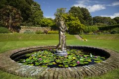 Neptune fountain. An old stone fountain depicting neptune Stock Images