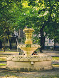 Old stone fountain with dripping water Stock Photos