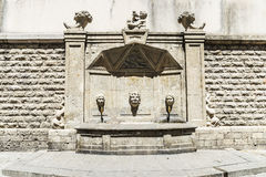 Old stone fountain in the old town of Barcelona Stock Photo