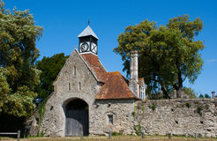 Old stone gatehouse with Tudor Clock Tower at the entrance to Beaulieu Abbey in the New Forest in the south of England Stock Images