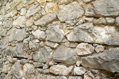 Old stone gray wall, close-up. Stone background. Stone background. Stone, old, beige grey white wall close-up. Close-up of weathered stone wall Royalty Free Stock Photo
