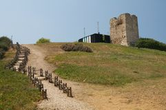 Old stone Greek tower. Old stone tower on hillside on island of Halkidiki, Greece Royalty Free Stock Photo