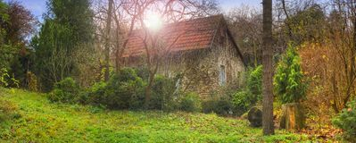 Old stone home in the forest Royalty Free Stock Photo