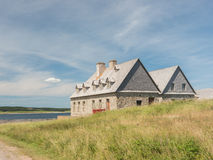 Old stone home on waterfront Royalty Free Stock Photos