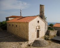 Old stone house. At the blue sky, in Ulcinj, Montenegro Stock Photo