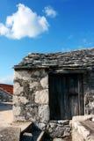 Old stone house. With white cloud on blue sky in town Sveta Nedilja on island Hvar in Croatia Stock Images