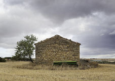 Old Stone House. In the middle of the field with trees and nature Royalty Free Stock Images