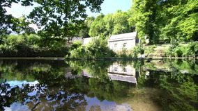 Old stone house with beautiful reflection stock footage