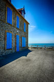 Old stone house with blue shutters Royalty Free Stock Photography
