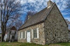 Old stone house. On a blue sky Stock Photos