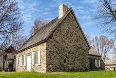 Old stone house. On a blue sky Stock Images