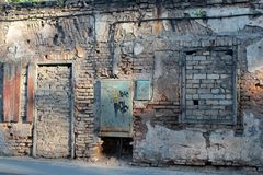 An old stone house with boarded  up doors and windows brick Royalty Free Stock Photo