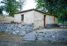 Old stone house with ceramic roof Stock Images
