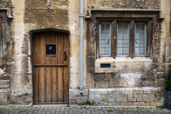Old Stone House Cotswolds. Details of door and window exterior on typical quaint stone Cotswolds home Stock Image