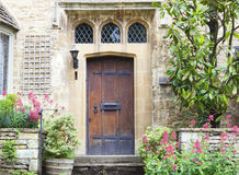 Old stone house with doors and front garden Stock Image