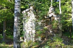 Old stone house in a forest. In a wooded area close to a lake is this old stone house Stock Photo