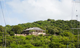 Old Stone House on Green Tropical Hill Royalty Free Stock Image