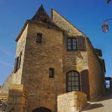 Old stone house in la roque gageac. Old stone house in a street corner at la roque gageac in Dordogne Stock Photos