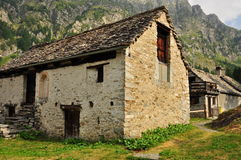 Old stone house and meadow in the Italian Alps Royalty Free Stock Photo