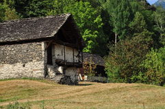 Old stone house and meadow in the Italian Alps Stock Photography