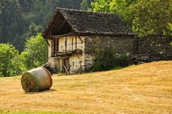 Old stone house and meadow in the Italian Alps