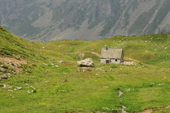 Old stone house and meadow in the Italian Alps Stock Photo