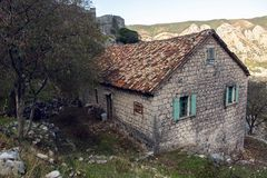 Old stone house in the mountains. With green Windows with fortress Stock Photography