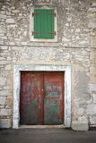 Old stone house with shutters in front view Royalty Free Stock Photo