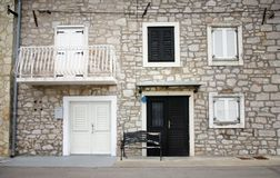 Old stone house with shutters in front view Stock Photography