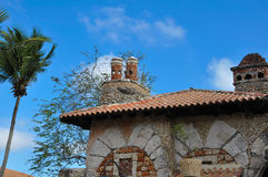 Old stone house in the Spanish style with red tile roof Stock Photo