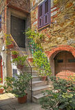 Old stone house with stairs, Tuscany, Italy. royalty free stock image