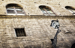 Old stone house with street lamp in the city center of Florence, Royalty Free Stock Photo