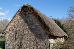 Old stone house with thatched roof royalty free stock images
