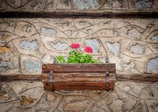Old Stone House Wall With Flowers in The Pot stock images