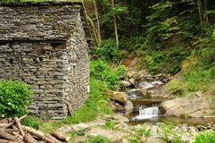 Old stone house and water stream waterfalls. Stock Photo