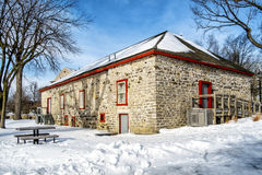Old stone house. Winter scene beside a canal with ice on a nice sunny day Stock Photos