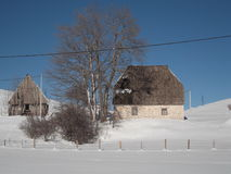 Old stone house  in winter. Old stone house with shingle roof in winter Royalty Free Stock Images