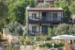 Old stone house with wooden balcony in Turkey Stock Images