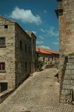 Old stone houses on a corner of deserted alley in Monsanto. Charming facade of old stone houses on a corner of deserted alley, in a sunny day at Monsanto royalty free stock photo