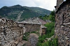 Old stone houses covered with plates in Cërnalevë village, northeastern Albania Stock Image