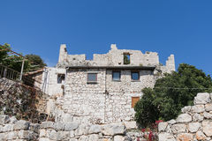 Old stone houses in Kalekoy Simena bay in Uchagiz Turkey Royalty Free Stock Photos