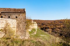 Old stone houses of Medieval cave city-fortress Chufut-Kale in the mountains, Bakhchisaray, Crimea royalty free stock photography