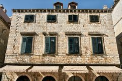 Old stone houses with windows with shutters and canopy stock image