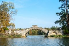 Old stone hump-back bridge in Gatchina.  Russia Stock Photography