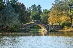 Old stone hump-back bridge in Gatchina.  Russia Royalty Free Stock Images